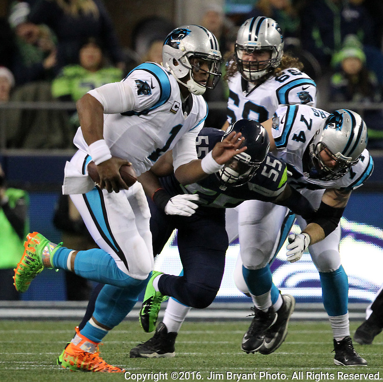 Carolina Panthers quarterback Cam Newton (1) away from Seattle Seahawks defensive end Frank Clark (55) at CenturyLink Field in Seattle, Washington on December 4, 2016.  Seahawks beat the Panthers 40-7.  ©2016. Jim Bryant photo. All Rights Reserved.