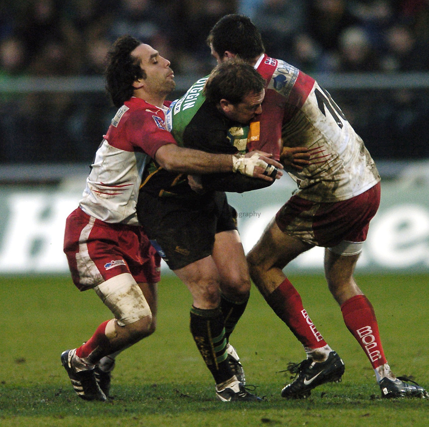 Photo: Jonathan Butler..Northampton Saints v Biarrtiz. Heineken Cup. 21/01/2007..Paul Diggin of Northampton is tackled by two Biarritz defenders.
