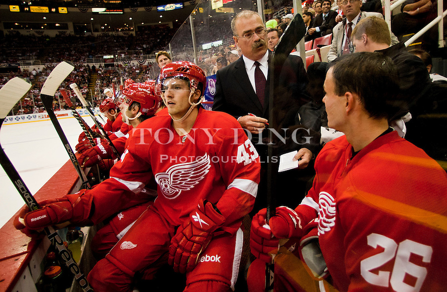 8 October 2010: Detroit Red Wings forward Darren Helm (43) and forward Jiri Hudler (26) gets advice from assistant coach Paul MacLean, in the second period of the Anaheim Ducks at Detroit Red Wings NHL hockey game, at Joe Louis Arena, in Detroit, MI...***** Editorial Use Only *****