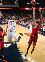 Virginia guard Justin Anderson (23) reaches for the rebound with Maryland guard/forward Dez Wells (32) during the game Sunday in Charlottesville, VA. Virginia defeated Maryland in overtime 61-58.Photo/Andrew Shurtleff