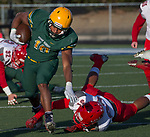 Bishop Manogue Miners  Peyton Dixon (10) runs out of the attempted tackle by Arbor View Aggies Devin Ramirez (31) in the second half of their NIAA 4A State Semi-Final football game played at McQueen High School on Saturday, Nov. 24,2018.