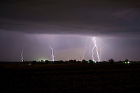Evening storm lightning strikes
