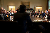 Washington, DC - December 9, 2009 -- United States President Barack Obama and bipartisan Congressional leaders listen to U.S. Secretary of the Treasury Timothy Geithner during a meeting in the Cabinet Room of the White House, Wednesday, December 9, 2009.  From left to right: U.S. Senator Chuck Grassley (Republican of Iowa), U.S. Senator Mike Enzi (Republican of Wyoming), U.S. Senator Chuck Schumer (Democrat of New York), Vice President Joseph Biden, unidentified, U.S. Representative Chris Van Hollen (Democrat of Maryland), unidentified, Secretary Geithner, U.S. Representative Eric Cantor (Republican of Virginia), U.S. Representative James E. Clyburn (Democrat of South Carolina), U.S. House Majority Leader Steny Hoyer (Democrat of Maryland), U.S. House Republican Leader John Boehner (Republican of Ohio), President Obama, U.S. Senate Majority Leader Harry Reid (Democrat of Nevada) and U.S. Senate Republican Leader Mitch McConnell (Republican of Kentucky).Mandatory Credit: Pete Souza - White House via CNP