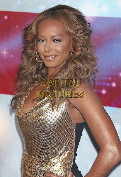 "Mel B (Melanie Brown).""America's Got Talent"" Los Angeles Auditions held at the Pantages Theatre, Los Angeles, California, USA..April 24th, 2013.half length gold metallic dress cowl neck side.CAP/ADM/RE.©Russ Elliot/AdMedia/Capital Pictures."