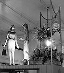 Pittsburgh PA: View of Christmas in store display at Horne's department store in downtown Pittsburgh. Women dressed up for the season surrounded by a steel display during the Rhapsody of Steel campaign.  US Steel launched an awareness campaign of all the current uses of steel in everyday products.  During this time, ALCOA Aluminum Company of America also headquartered in Pittsburgh, was aggressively competing to enter markets where US  steel companies traditional dominated market share. Examples included beer and food Cans, appliances, automobile parts, children toys / bicycles, and more.
