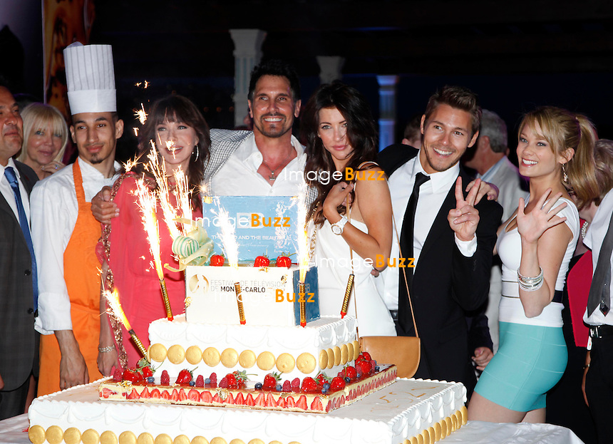 """ 'The Bold and The Beautiful' "" cast (L-R) Hunter Tylo, Don Diamont, Jacqueline Mac Innes Wood, Scott Clifton and Kim Matula pose behind the cake at the 25th Years Anniversary of 'The Bold and The Beautiful' at Monte Carlo Bay on June 11, 2012 in Monte-Carlo, Monaco."