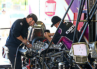 Jun. 1, 2014; Englishtown, NJ, USA; Crew members for NHRA top fuel driver Leah Pritchett during the Summernationals at Raceway Park. Mandatory Credit: Mark J. Rebilas-