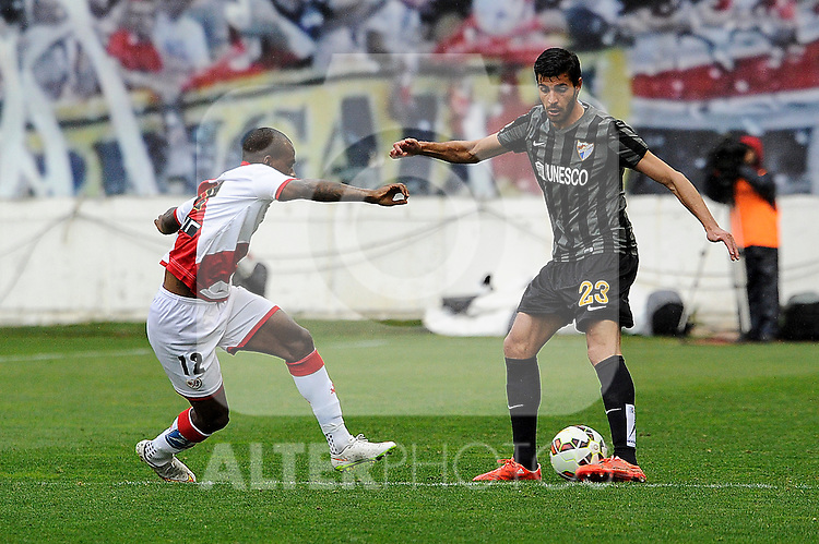 Rayo Vallecano´s Gael Kakuta and Malaga CF´s Miguel Torres Gomez during 2014-15 La Liga match between Rayo Vallecano and Malaga CF at Rayo Vallecano stadium in Madrid, Spain. March 21, 2015. (ALTERPHOTOS/Luis Fernandez)