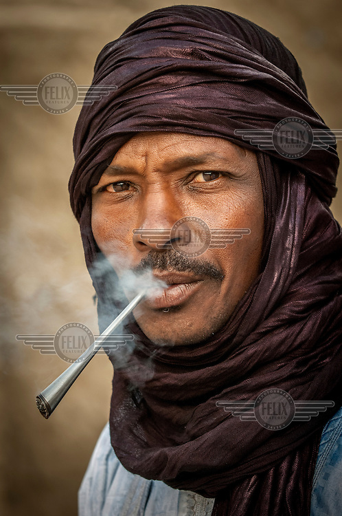 A portrait of a man smoking in Timbuktu. /Felix Features