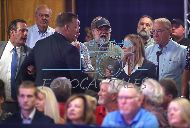 Catherine Byrne, center, who's son is in the Air Force, asks Republican Vice Presidential candidate Mike Pence about Donald Trump's disrespect for the military during a rally in Carson City, Nev., on Monday, Aug. 1, 2016. The crowd responded with jeers and boos but Pence answered her question. Cathleen Allison/Las Vegas Review Journal