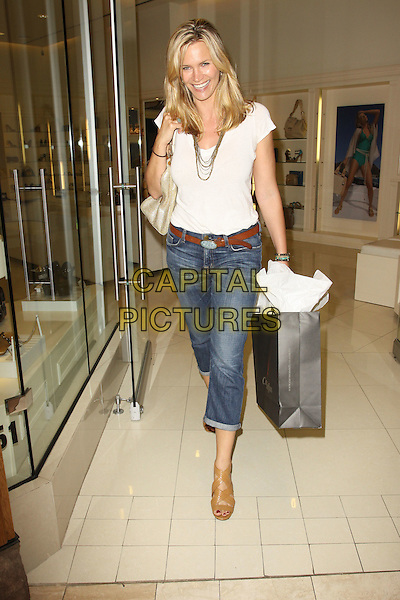 NATASHA HENSTRIDGE.Natasha Henstridge Visits Gifting Services held at Gifting Services Showroom, Los Angeles, CA, USA..June 3rd, 2010.full length white top jeans denim rolled turned up sandals beige bag purse shopping .CAP/ADM/KB.©Kevan Brooks/AdMedia/Capital Pictures.