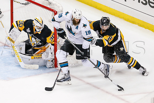 June 1, 2016:  San Jose Sharks center Joe Thornton (19) skates with the puck as Pittsburgh Penguins defenseman Brian Dumoulin (8) defends and Pittsburgh Penguins goalie Matt Murray (30) prepares to make save during the San Jose Sharks and Pittsburgh Penguins NHL Stanley Cup playoff game at Consol Energy Center in Pittsburgh, PA. Pittsburgh beat San Jose in overtime, 2-1.