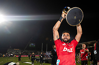Crusader Richie Mo'unga celebrates with the trophy following the 2018 Super Rugby final between the Crusaders and Lions at AMI Stadium in Christchurch, New Zealand on Sunday, 29 July 2018. Photo: Joe Johnson / lintottphoto.co.nz