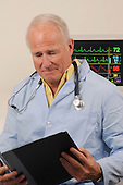 Senior medical MD with vital monitor stock photo