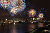 WEEHAWKEN, NJ - JULY 4: The annual Macy's Fourth of July fireworks extravaganza lights the sky over the Hudson river on Monday, July 4, 2011 as seen from Weehawken, New Jersey on the west side of the river looking south toward lower Manhattan.