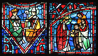 Fulbert as advisor to King Robert the Pious (left) and Fulbert giving alms to a poor family (right), from the Life of Fulbert stained glass window, in the south transept of Chartres Cathedral, Eure-et-Loir, France. This window replaces the original 13th century window depicting the Life of St Blaise, which was destroyed in 1791. It was created in 1954 by Francois Lorin as a gift of the Institute of American Architects, on a theme chosen by the Canon Yves Delaporte. It depicts the life of Fulbert, bishop of Chartres in the 11th century. Chartres cathedral was built 1194-1250 and is a fine example of Gothic architecture. Most of its windows date from 1205-40 although a few earlier 12th century examples are also intact. It was declared a UNESCO World Heritage Site in 1979. Picture by Manuel Cohen