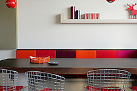 Seating either side of the long dining table combines a colourful banquette and a set of Bertoia Diamond dining chairs