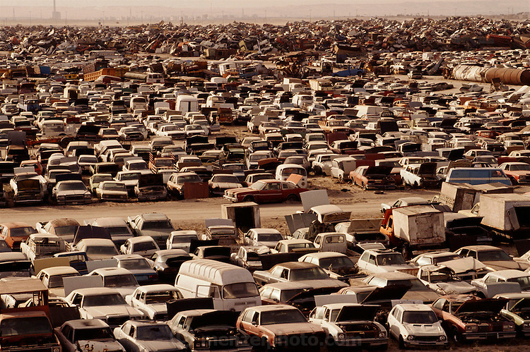 Scrap metal junkyard in the Kuwaiti desert with 100,000 of the 300,000 cars destroyed from the Iraqi war. More than 700 wells were set ablaze by retreating Iraqi troops creating the largest man-made environmental disaster in history.