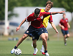 Claudio Reyna (in red) is defended by Michael Bradley (behind) on Sunday, May 14th, 2006 at SAS Soccer Park in Cary, North Carolina. The United States Men's National Soccer Team held a training session as part of their preparations for the upcoming 2006 FIFA World Cup Finals being held in Germany.