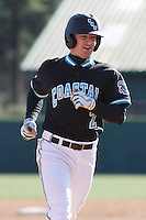 Chance Gilmore of the Coastal Carolina University Chanticleers rounding the bases after a home run during a game against NC State University at the Baseball at the Beach Tournament held at BB&T Coastal Field in Myrtle Beach, SC on February 28, 2010.