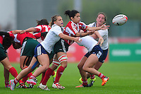 Rafaela Xavier of Portugal passes the ball. FISU World University Championship Rugby Sevens Women's Semi Final between France and Portugal on July 9, 2016 at the Swansea University International Sports Village in Swansea, Wales. Photo by: Patrick Khachfe / Onside Images
