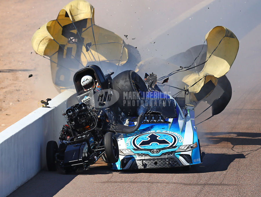 Feb 25, 2018; Chandler, AZ, USA; NHRA funny car driver John Force (left) crashes with Jonnie Lindberg during the Arizona Nationals at Wild Horse Pass Motorsports Park. Mandatory Credit: Mark J. Rebilas-USA TODAY Sports