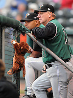 The Augusta Greenjackets have a stuffed mascot monkey named Norm. He was picked up by outfielder Dom Duggan as a good luck charm after the team lost 11 of 13 to begin the season. The team went on to win the next six of eight, and though they fell on another rough patch, the monkey stays, largely at Duggan's request. He's become a pseudo-celebrity, having been featured in the Augusta Chronicle and on local television station WJBF, our ABC affiliate, says Eric Little, the GreenJackets' media relations staffer. He is shown here with hitting coach Lipso Nava (17), left, and manager Dave Machemer (21).