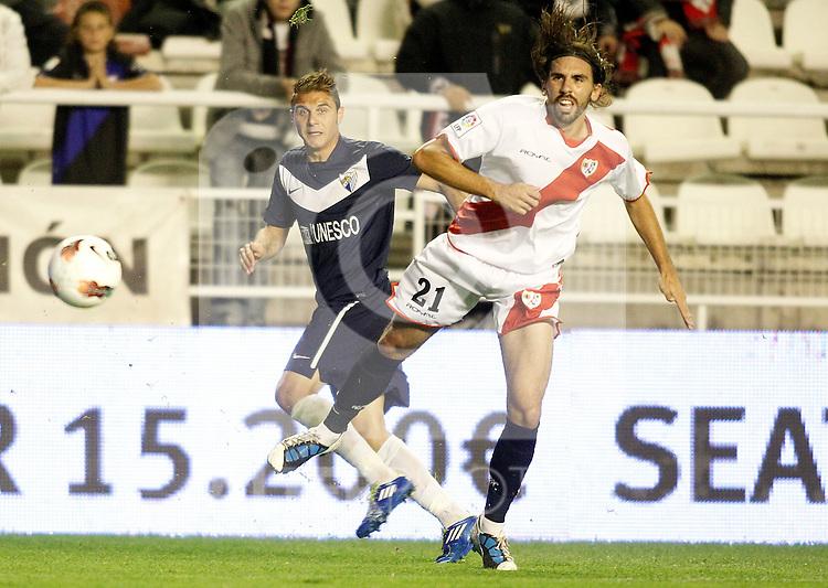 Malaga's Joaquin Sanchez against Rayo Vallecano's Jordi Figueras during La Liga Match. October 26, 2011. (ALTERPHOTOS/Alvaro Hernandez)