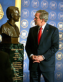 Washington, D.C. - February 9, 2006 -- United States President George W. Bush looks at a commemorative bronze bust of himself as a First Lieutenant in the Texas Air National Guard after making remarks on the Global War on Terror at the National Guard Memorial Building in Washington, D.C. on February 9, 2006. <br /> Credit: Ron Sachs / CNP