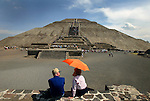 TEOTIHUACAN, MEXICO - OCTOBER 14: An older couple sit down and relax while visiting the Pyramid of the Sun on October 14, 2002 in Teotihuacan, Mexico (Photo By Donald Miralle)