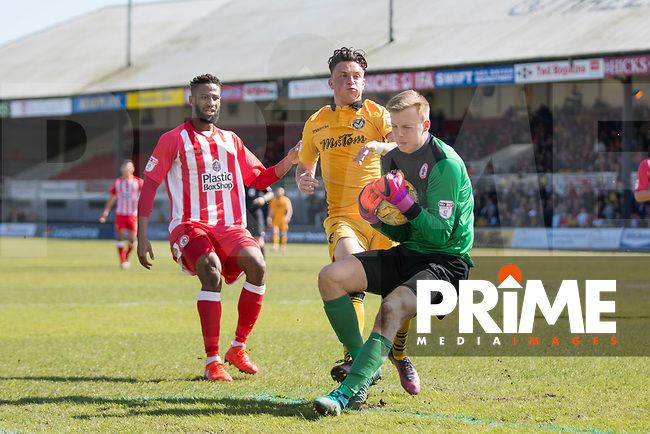 Marek Rodak of Accrington Stanley catches the ball under pressure from Tom Owen-Evans of Newport County during the Sky Bet League 2 match between Newport County and Accrington Stanley at Rodney Parade, Newport, Wales on 22 April 2017. Photo by Mark  Hawkins.
