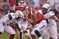 STAFF PHOTO BEN GOFF  @NWABenGoff -- 09/20/14 <br /> Arkansas running back Jonathan Williams evades Northern Illinois defenders Rasheen Lemon (9) and Donovan Gordon (94) on his way to a touchdown during the first quarter of the game against Northern Illinois in Reynolds Razorback Stadium in Fayetteville on Saturday September 20, 2014.