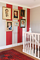 A display of generations of family portraits on the staircase landing