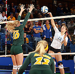 BROOKINGS, SD - OCTOBER 26:  Emily Veldman #12 from South Dakota State tries for a kill past Hadley Steffen #10 from North Dakota State in the third game of their match Saturday evening at Frost Arena in Brookings. (Photo by Dave Eggen/Inertia)