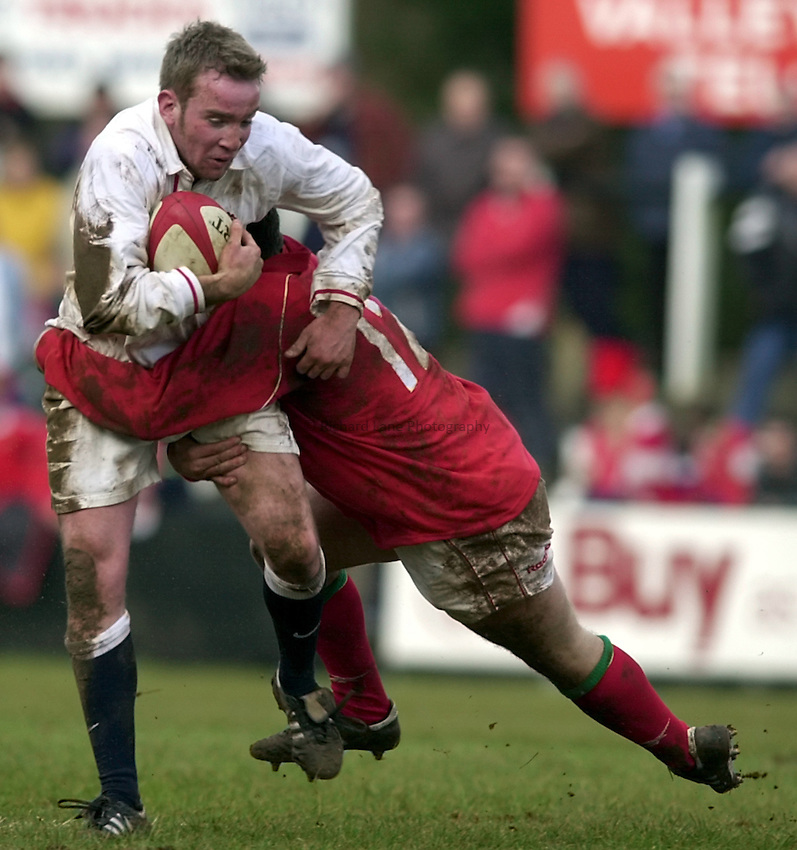 Photo. Richard Lane. .Wales U21 v England U21 at Sardis Road, Pontypridd, Wales. 2/2/2001.Sean Marsden is tackled by Matthew Bradley.