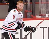 Adam Reid (NU - 8) - The visiting University of Vermont Catamounts defeated the Northeastern University Huskies 6-2 on Saturday, October 11, 2014, at Matthews Arena in Boston, Massachusetts.