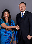 13 March 2013, New Delhi, India: President of the World Bank, Mr Jim Yong Kim  shakes hands with  Renu Malhan  of the World Bank staff congratulating her for twenty years of service with the Bank. Mr.Kim is visiting India  for meetings with local staff, Indian Government Ministers and to inspect projects sponsored by World Bank in regional areas. Picture by Graham Crouch/World Bank
