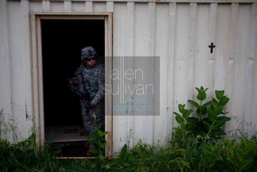 A US Army soldier trains in a scenario in an imitation Afghan village during a media visit day at Camp Atterbury, Indiana on Wednesday, June 3, 2009.