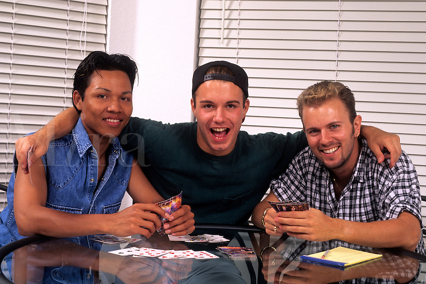 Gay male friends playing cards.