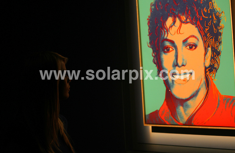 **ALL ROUND PICTURES FROM SOLARPIX.COM**.**WORLDWIDE SYNDICATION RIGHTS**.Two 14 year old girls view the display of Andy Warhol's portrait of The King of Pop Michael Jackson at the British Music Experience exhibition at the 02 Arena in North Greenwich, London. The auction of the portrait will start with an opening bid of 800,000 USD. London, UK. 5 August 2009. ..This pic: Warhol Michael Jackson..JOB REF: 9705 LNJ     DATE: 05_08_2009.**MUST CREDIT SOLARPIX.COM OR DOUBLE FEE WILL BE CHARGED**.**MUST NOTIFY SOLARPIX OF ONLINE USAGE**.**CALL US ON: +34 952 811 768 or LOW RATE FROM UK 0844 617 7637**