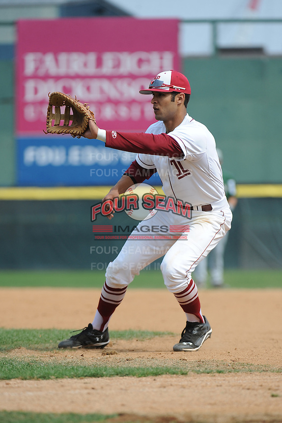 Temple University Owls infielder Robert Amaro (20) during warmups before a game against the University of South Florida Bulls at Campbell's Field on April 13, 2014 in Camden, New Jersey. USF defeated Temple 6-3.  (Tomasso DeRosa/ Four Seam Images)