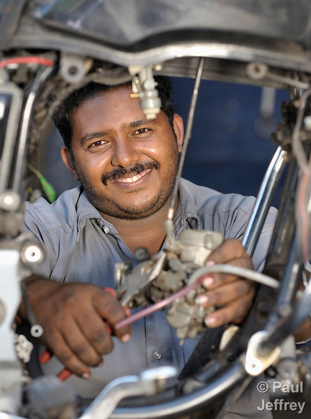 Chhandrasekar works on a bike engine in his motorcycle repair shop in Ottiyambakkam, a village in the state of Tamil Nadu in southern India..