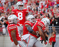 Ohio State Buckeyes linebacker Darron Lee (43, right) celebrates with Ohio State Buckeyes linebacker Joshua Perry (37), Ohio State Buckeyes cornerback Gareon Conley (8) and Ohio State Buckeyes safety Vonn Bell (11) after Lee's interception for a touchdown during the second half of the NCAA football game between the Ohio State Buckeyes and the Northern Illinois Huskies at Ohio Stadium on Saturday, September 19, 2015. (Columbus Dispatch photo by Jonathan Quilter)