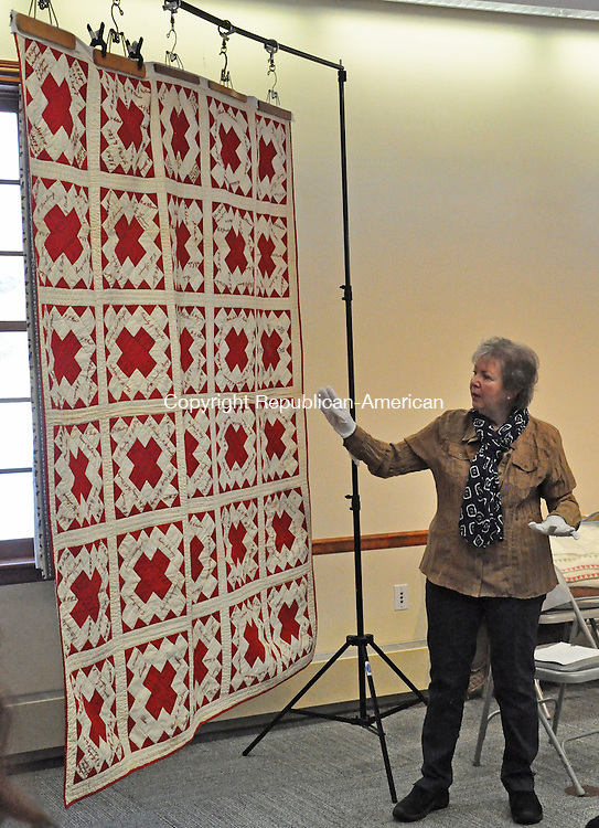 KENT, CT – 14 January 2014 - 011414LMW03 – Quilt expert Sue Reich of Washington points out details in a quilt that dates back to 1894 that was owned by the Rev. Benjamin Wright, a minister at the First Congregational Church of Kent. It contains the embroidered signatures of 250 people who lived in Kent at the time. Reich shared her knowledge about determining the age and value of quilts with the 64 people who attended a presentation 'Learning History From Quilts,' that was held by the Kent Historical Society Sunday afternoon at Kent Town Hall. CONTRIBUTED