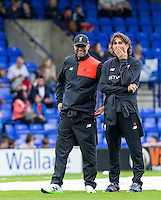 Liverpool Manager Jurgen Klopp laughs as Assistant Coach Zeljko Buvac covers his face during the 2016/17 Pre Season Friendly match between Tranmere Rovers and Liverpool at Prenton Park, Birkenhead, England on 8 July 2016. Photo by PRiME Media Images.