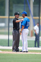 GCL Blue Jays manager Luis Hurtado (31) argues with first base umpire Caleb Stone during a game against the GCL Pirates on July 20, 2017 at Bobby Mattick Training Center at Englebert Complex in Dunedin, Florida.  GCL Pirates defeated the GCL Blue Jays 11-6 in eleven innings.  (Mike Janes/Four Seam Images)