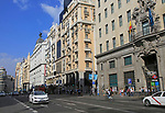 Traffic historic buildings busy road of Gran Via, Madrid city centre, Spain