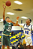 Kahleel Gunn #21 of Holy Trinity, left, and DJ Faulk #12 of Hempstead battle for a loose ball during a varsity boys' basketball game at Baldwin High School on Tuesday, Dec. 29, 2015. Holy Trinity won by a score of 70-58.