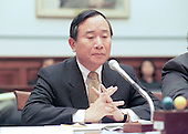 Former Democratic fund raiser John Huang testifies before the United States House Government Operations Committee to answer charges he arrange nearly one million dollars in illegal contributions for the Clinton-Gore re-election campaign in 1996 on 15 December, 1999.<br /> Credit: Ron Sachs / CNP