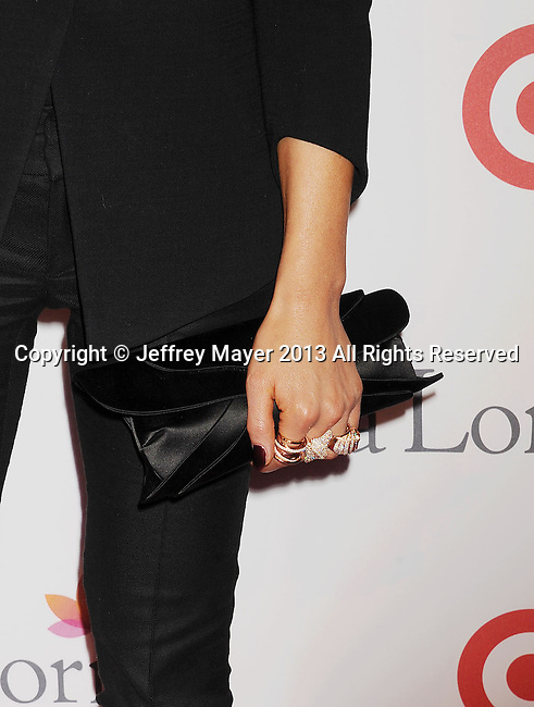 HOLLYWOOD, CA- SEPTEMBER 28: Actress Kate Beckinsale (handbag, rings detail) at the Eva Longoria Foundation Dinner at Beso restaurant on September 28, 2013 in Hollywood, California.